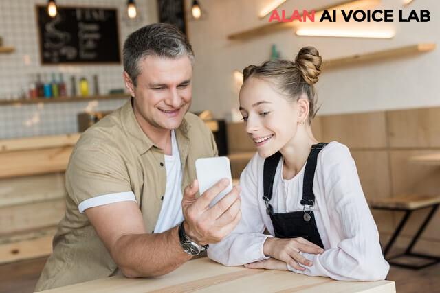 father-daughter-smartphone-investing-medium
